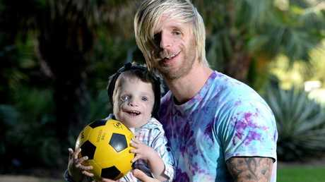 Zack, then aged 2, with Jono Lancaster from the UK, visiting in 2014. Picture: Noelle Bobrige