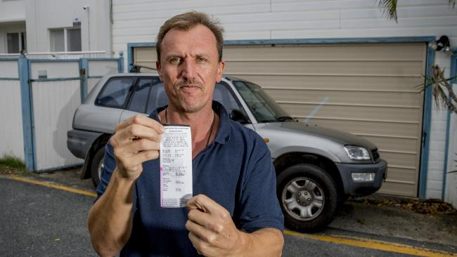 Johnathon Dao has lived in his Palm Beach home for the past five years and has always parked parallel in his small driveway. Yesterday he came out to find a $157 parking fine on his car, parking in his own driveway. Picture: Jerad Williams