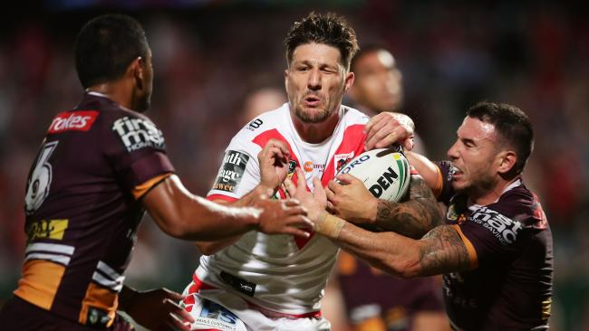 Gareth Widdop charges into the Broncos defence.