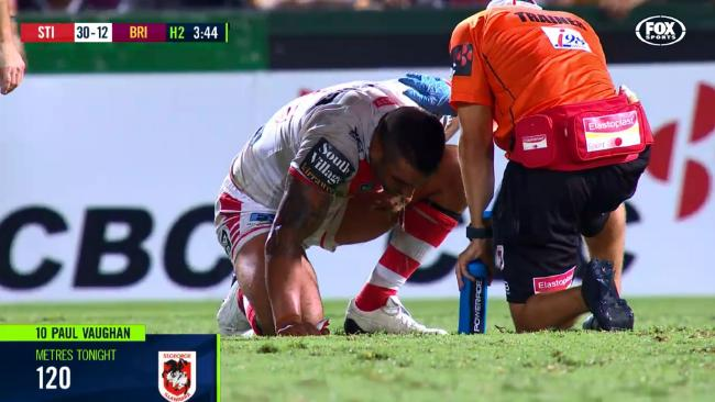 Paul Vaughan vomits on the field after being shoulder charged.