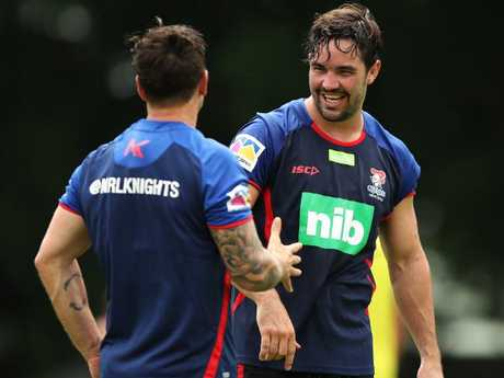 Mitchell Pearce and Aidan Guerra at training.