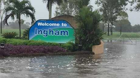 The iconic welcome to Ingham sign has been inundated with water. Picture: Tracey Castles