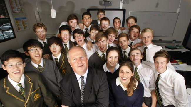 Rohan Brown with Trinity Grammar students in 2012.