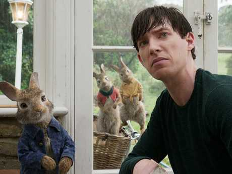 Peter Rabbit (James Corden) with his nemesis Mr. McGregor (Domhnall Gleeson) in Peter Rabbit.