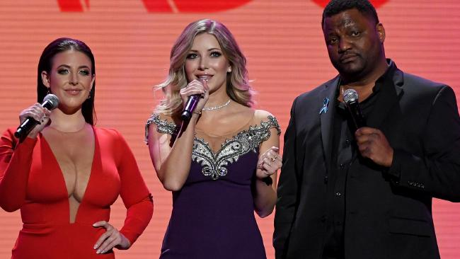 Angela White on stage with fellow presenters webcam model Harli Lotts and actor/comedian Aries Spears at the Adult Video News Awards. Picture: Ethan Miller/Getty Angela White, the Aussie porn star owning the US