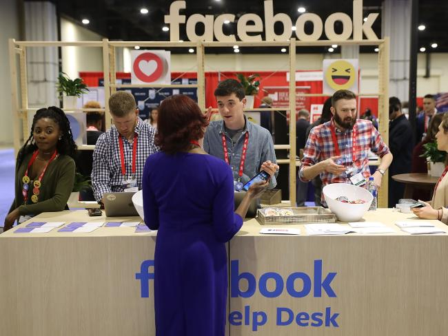 Attendees visit the Facebook Help Desk inside the Conservative Political Action Conference Hub in February 2018.