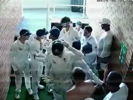 Warner had to be restrained by his teammates.