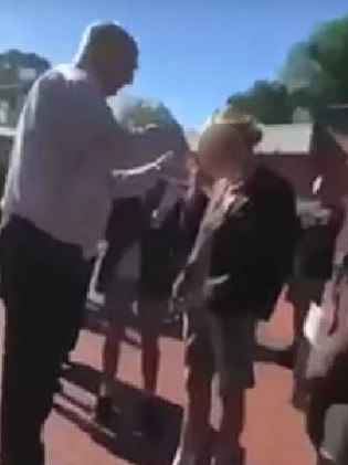 The deputy principal was filmed cutting the student's hair.