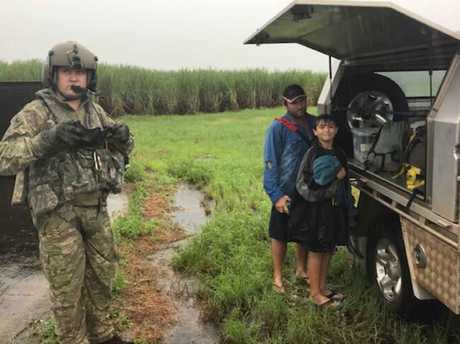 An Army helicopter flew in supplies to stranded school kids.
