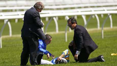 Hugh Bowman talks to fellow jockey Brenton Avdulla and ATC officials after the fall. Picture: AAP