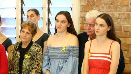 Allison Baden-Clay's two eldest daughters Sarah, 14, in blue, and Hannah, 16, in red, with their grandparents. Picture: Liam Kidston