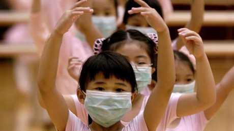 Children in Hong Kong learning ballet lessons wear masks to protect themselves from Severe Acute Respiratory Syndrome (SARS) in 2003.