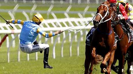 Only a rein keeps Hugh Bowman attached to Performer. Picture: AAP