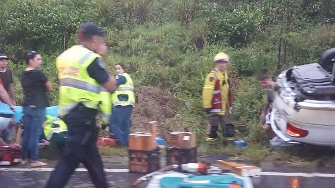 A car has crashed on the Warrego Highway.