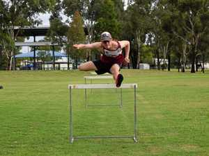 Youth athlete prepares to hurdle competition