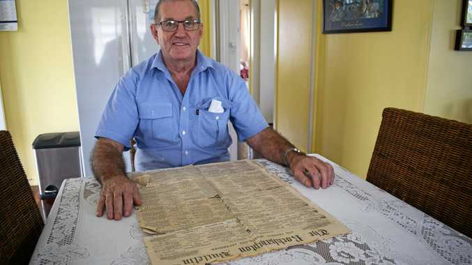 Richard Ouston with a 1864 newspaper he found at his mother's house from.