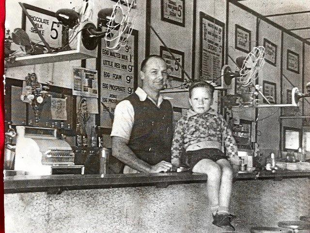 BACK IN TIME: Trevor Rutherford with his Dad, Phillip, owner of Rutherford's Milk Bar on Wood St about 1952.