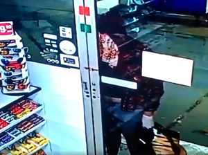 CCTV: Would-be robber knocks on locked servo door with knife