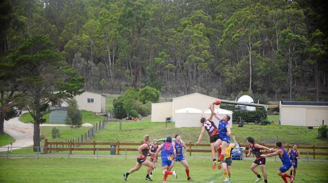 Warwick Redbacks ruckman Alex Cutmore (leaping on right) and an Ipswich Eagles ruckman go for the ball in the Cardinal Cup at Warwick Credit Union Oval.
