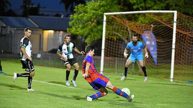 GOAL ATTEMPT: Buccaneers player Shaun Mitchell kicks for goal during their game in Bundaberg on Saturday night.