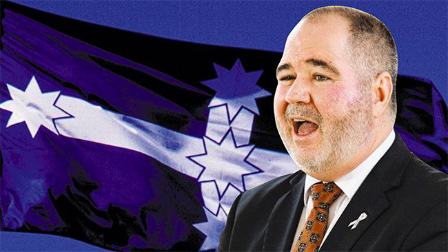 Queensland Teachers' Union president Kevin Bates and the Eureka Stockade flag that signifies solidarity with the construction union.