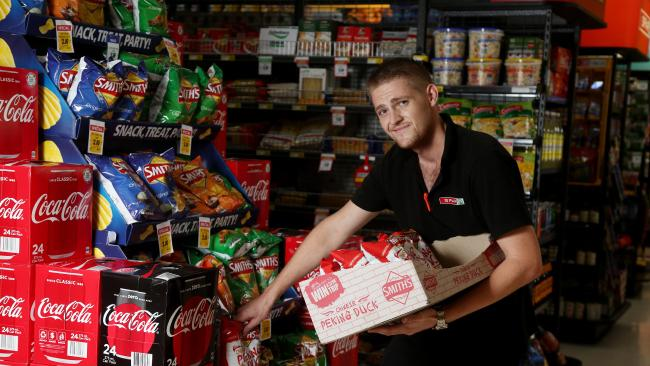 Kane Woolley restacking shelves at the Spar store, Holloways Beach after fresh supplies arrive. PICTURE: STEWART MCLEAN