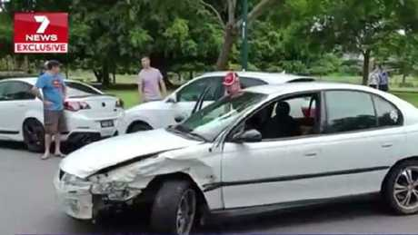 The man leaves his vehicle after he used it to ram other cars park in New Farm Park. Picture: 7 News Brisbane