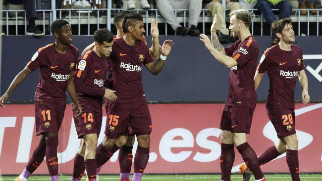 Barcelona's Coutinho celebrates with team mates