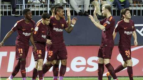 Barcelona's Coutinho celebrates with team mates