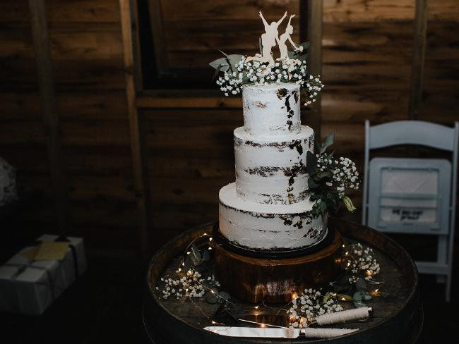 The three-tiered wedding cake was made by a family friend who is an 'excellent baker'. Picture: Bulb Creative