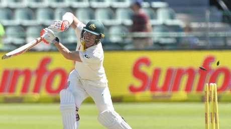 David Warner is bowled by Kagiso Rabada.
