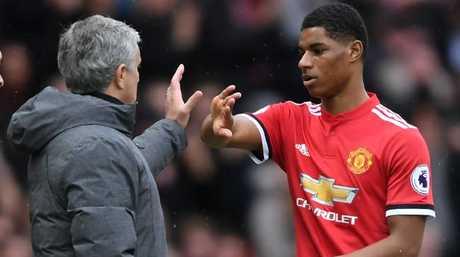 Jose Mourinho, Manager of Manchester United speaks with Marcus Rashford