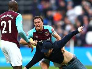 West Ham disgrace: Captain brawls with fan in shocking invasion