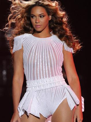 Beyonce performs on the opening night of her Mrs. Carter Show World Tour 2013 chose to wear a hand beaded white peplum one-piece by designers Ralph & Russo. Picture: AP