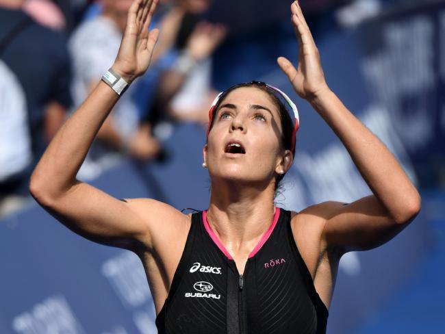 Ashleigh Gentle celebrates winning the Noosa triathlon.