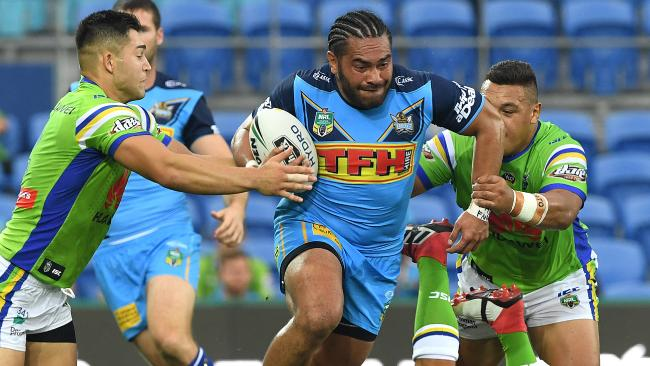 Konrad Hurrell on the charge for the Titans against the Raiders at Cbus Super Stadium.