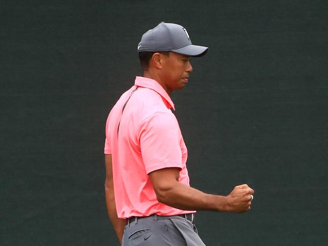 Tiger Woods reacts after a birdie on the ninth hole.