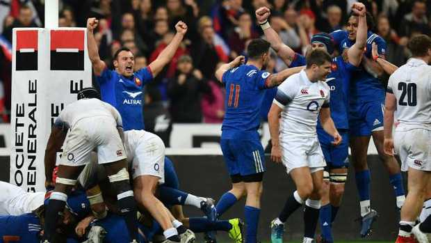 France players celebrate defeat of England.
