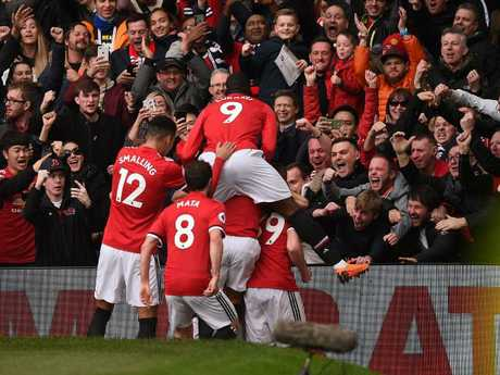 Manchester United's English striker Marcus Rashford celebrates