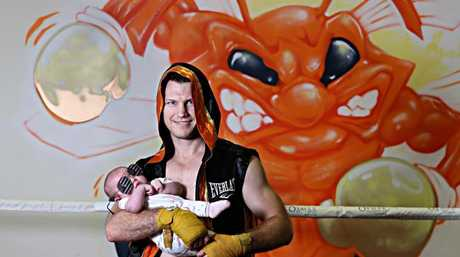 Jeff Horn with daughter Isabelle at his Stretton Boxing gym. Picture: Annette Dew