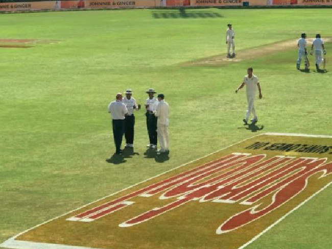 The umpires had to have a chat about the band.