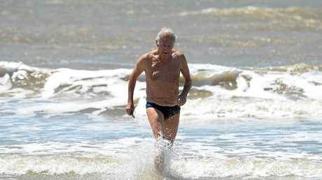 Brian Hooper, 83, competed in the surf swim at the memorial day  in Yeppoon.