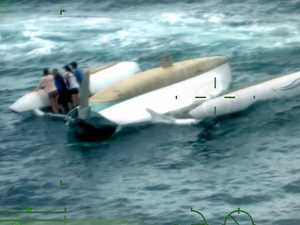 Four rescued as 33-foot vessel capsizes south of Coast