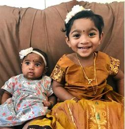 Priya and Nadesalingam's two daughters Dharuniga and Kopiga.