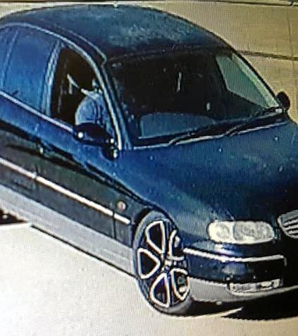 CCTV IMAGE: Police investigating two offences which may be linked want to speak with a man believed to be driving this blue sedan.