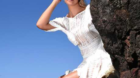 MODEL: Shelby Harasymenko gets ready for Miss World .
