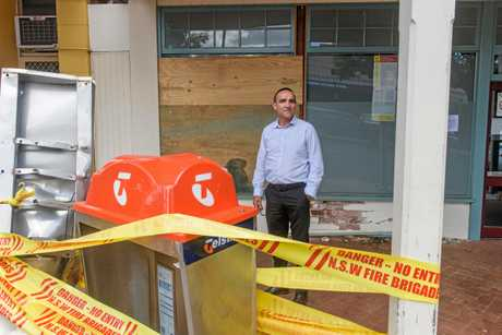 Bulgarr Ngaru Medical Aboriginal Corporation CEO Scott Monaghan looks at the damage to the outside of the Medical Centre that was hit by a car on Saturday.