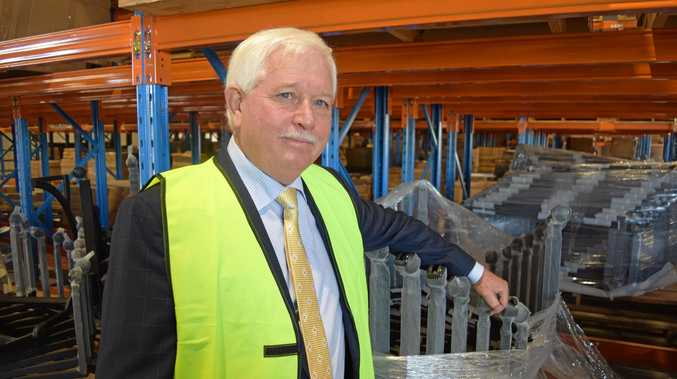 BizFurn founder Denis Moore celebrates the opening of a new  7,500sqm building at the company's Yandina base.