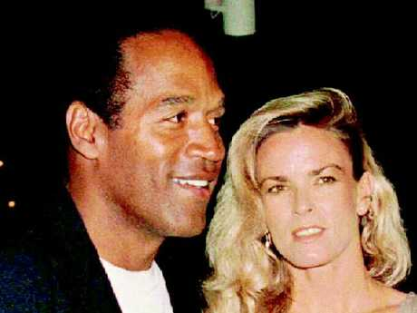 OJ Simpson and Nicole Brown at the premiere of 'Naked Gun 33 1/3,' three months before he is charged with her murder. Picture: Reuters