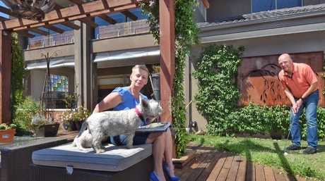 Jack and Jayne Todd with their dog Jack outside their house. Data shows the most popular house has four bedrooms and is on 708sq m, suggesting the Great Australian Dream of a house on a quarter acre block is not dead. Picture: Tony Gough